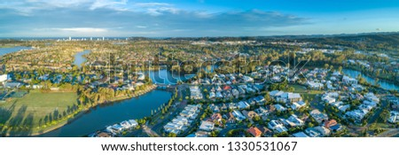 Aerial panorama of luxury suburb on the Gold Coast at sunset. #1330531067