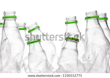 group of smashed empty plastic bottles with green caps, isolated on white background #1330552775