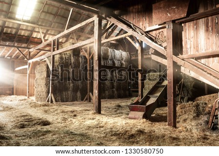 Inside Rustic Wooden Old Barn Hay Bales Straw Sunlight Rays Light Beams Farm #1330580750