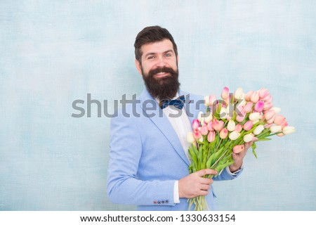 Flowers delivery. Gentleman romantic date. Birthday greetings. Best flowers for girlfriend. Flowers for her. Man bearded suit bow tie hold tulips bouquet. Gentleman making romantic surprise for her. #1330633154
