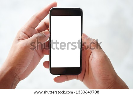 Cropped shot view of man hands holding smart phone with blank copy space screen for your text message or information content, female reading text message on cell telephone during in urban setting. #1330649708
