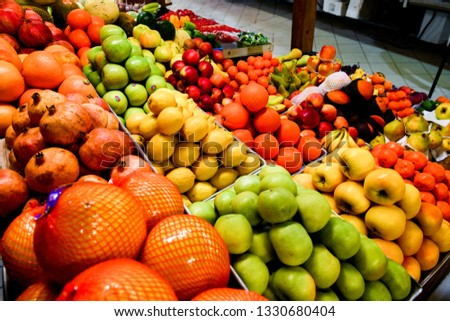 Fruits on the counter at grocery market. Garnet, lemon, apple, orange. Healthy food with vitamins on background. Good nutrition for diet or vegetarian #1330680404