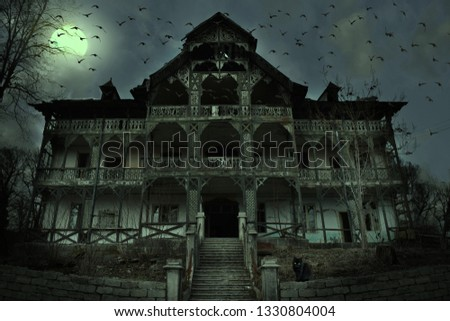 Old abandoned mansion in mystic spooky forest. Ancient haunted house with dark horror atmosphere Royalty-Free Stock Photo #1330804004