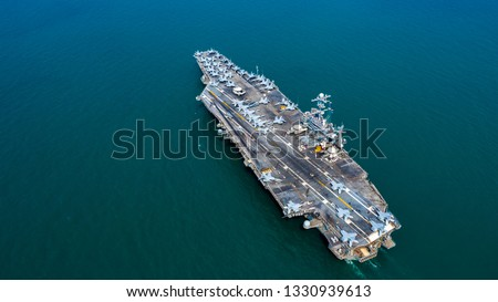 American battleship navy nuclear aircraft carrier, America military navy ship airplane carrier full loading plane fighter jet aircraft, Aerial view United States of America warship in open ocean. #1330939613
