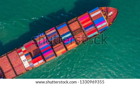 Container ship going to deep sea port, Business logistic import export shipping and transportation by container ship, Aerial view. #1330969355