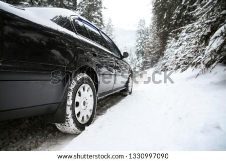 Car on road at snowy winter resort #1330997090
