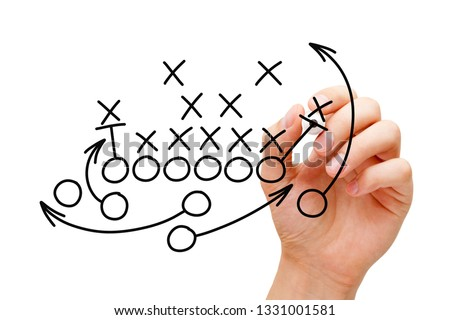 Coach drawing american football or rugby game playbook, tactics and strategy with black marker on white background.  #1331001581