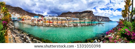 Grand Canary holidays - beautiful Puerto de Mogan, popular tourist attraction in Canary islands Royalty-Free Stock Photo #1331010398