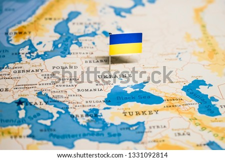the Flag of ukraine in the world map Royalty-Free Stock Photo #1331092814