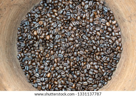 Roasted coffee beans in a clay pot in the local market, Bali, Indonesia. Close up, top view #1331137787