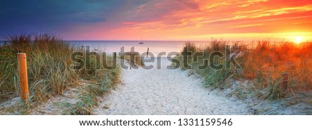 beach access - amazing light at the morning on the beach Royalty-Free Stock Photo #1331159546