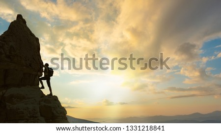 silhouette of successful climbing woman in mountains Concept of concept of motion motivation inspiration at beautiful sunset #1331218841