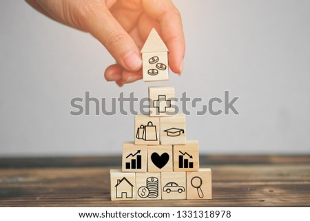 Wood block stacking as step stair and coins stacked, business growth to success.Startup concepts with business strategy symbols on wooden cubes - Risk management. #1331318978