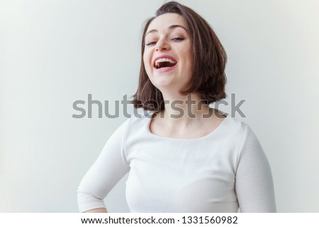 Happy girl smiling. Beauty portrait young happy positive laughing brunette woman on white background isolated. European woman. Positive human emotion facial expression body language #1331560982
