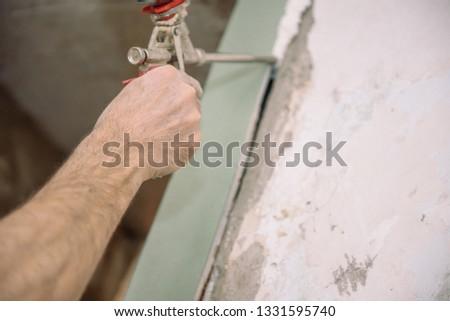 Construction foam. Foaming the door. Master Foam. Construction works. #1331595740