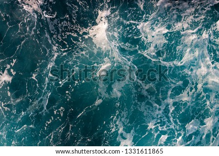 AERIAL VIEW OF REVOLTED WAVES IN THE MEDITERRANEAN SEA ILLUMINATED BY THE SUN #1331611865