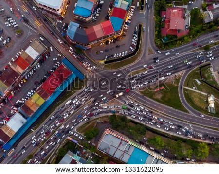 Aerial Drone image of car moving on surrounding Residential area at Kota Kinabalu, Sabah, Malaysia #1331622095