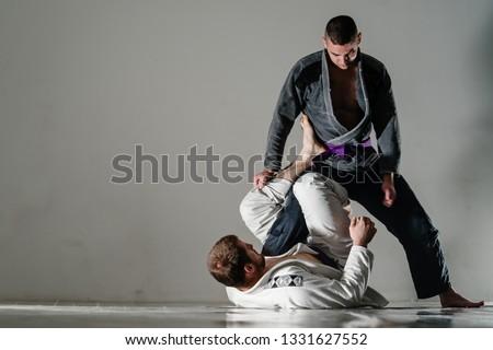 Brazilain Jiu JItsu BJJ Fighters in training sparing open x guard Royalty-Free Stock Photo #1331627552