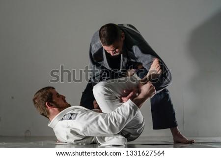 Brazilain Jiu JItsu BJJ Fighters in training sparing open spider guard Royalty-Free Stock Photo #1331627564