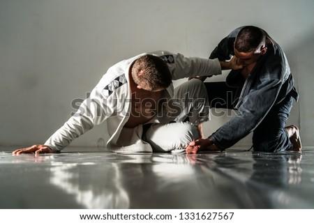 Brazilain Jiu JItsu BJJ Fighters in training sparing #1331627567