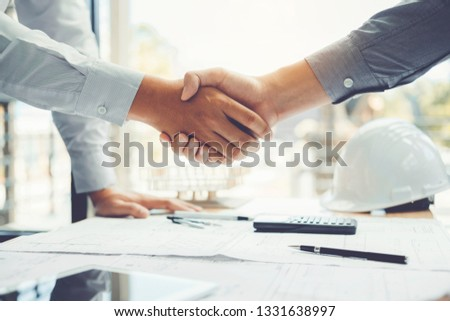 Engineer handshake meeting for architectural project and working with partner engineering on workplace #1331638997