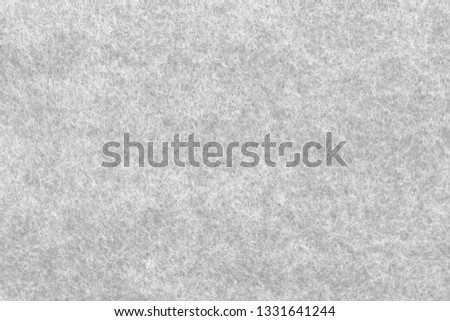 Soft grey felt material. Surface of felted fabric texture abstract background. High resolution photo. #1331641244