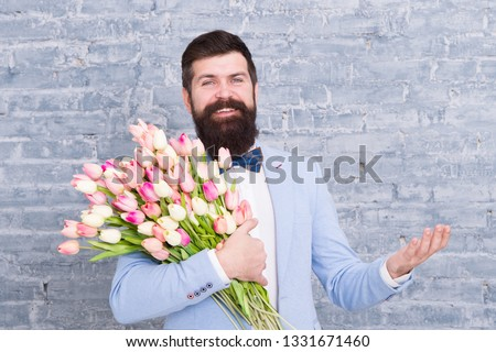 Express positivity. happy womens day. Flower for March 8. Spring gift. happy bearded man hipster with flowers, copy space. Bearded happy man with tulip bouquet. Love date. happy holiday. #1331671460