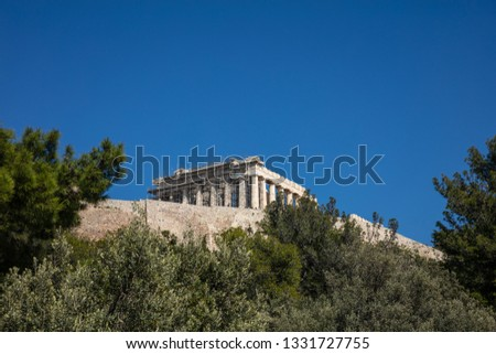 Acropolis of Athens Greece rock and Parthenon on blue sky background, sunny day. View from Dionisiou areopagitou str #1331727755