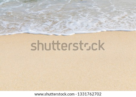 Soft wave of ocean on the sandy beach  #1331762702