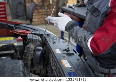 Mechanic changing oil #1331781965