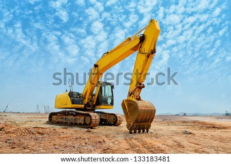 excavator loader machine during earthmoving works outdoors Royalty-Free Stock Photo #133183481