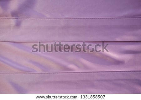 Close up pink fabric. The purple fabric is laid out waves. Fuchsia sateen fabric for background or texture. #1331858507