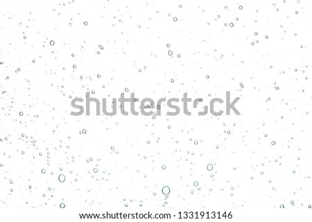 Transparent gel with bubbles close-up. The texture of gel cream. Oxygen bubbles in clear blue water, close-up. Mineral water. Water enriched with oxygen. Royalty-Free Stock Photo #1331913146