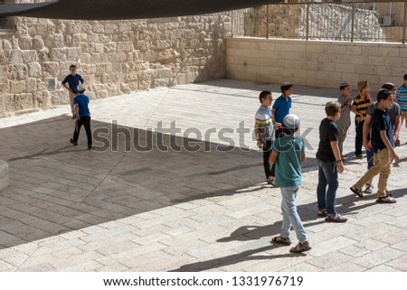 JERUSALEM, ISRAEL - MAY 16, 2018: School children playing on the streets of Jerusalem old city in the Jewish quarter #1331976719
