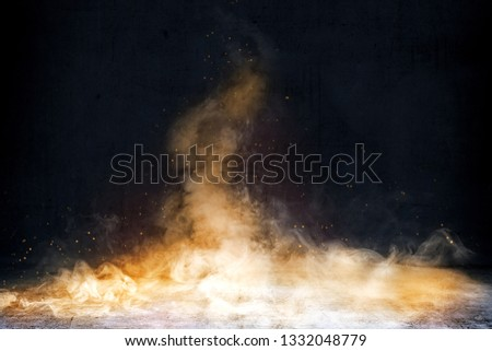 Room with concrete floor and smoke with fire sparks with dark wall background