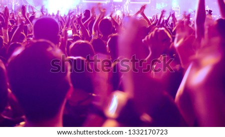 abstract colorful background audience in public concert. #1332170723