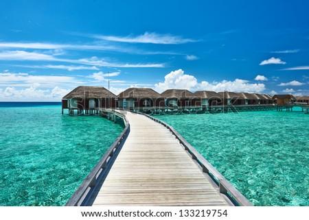 Beautiful beach with water bungalows at Maldives #133219754