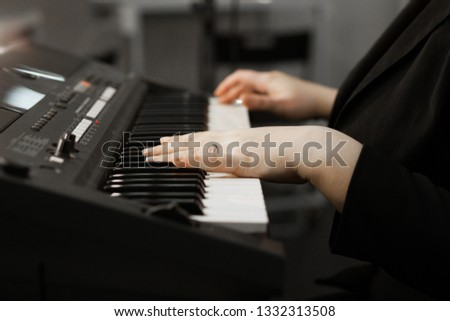 Close up of woman's hand playing the piano. Woman playing on electric piano. Female synthesizer player #1332313508