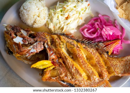 Pescado Frito - Whole deep fried fish with rice and salad traditional Mayan Mexican Dish  #1332380267