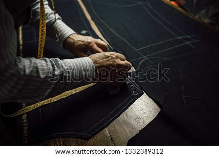 details of the working tailor #1332389312