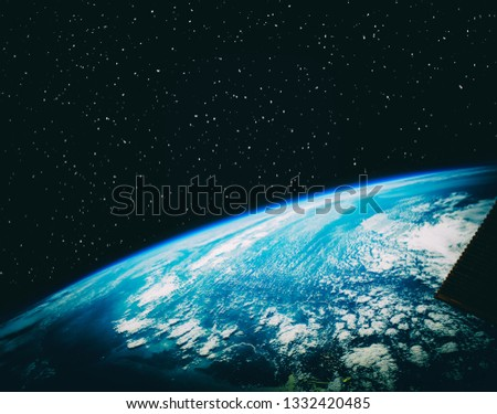 Earth and stars. Blue earth. Great for background.  The elements of this image furnished by NASA.  #1332420485