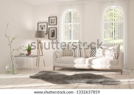 White stylish minimalist room with sofa and summer landscape in window. Scandinavian interior design. 3D illustration #1332637859