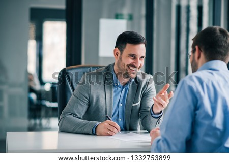 Man having a business meeting and signing a contract, recruitment or agreement. #1332753899