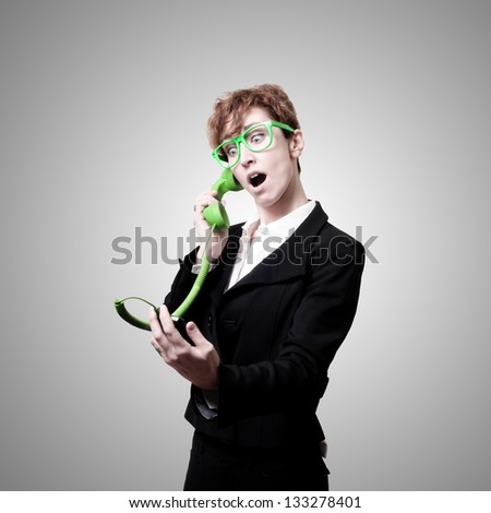 business woman with phone on gray background #133278401