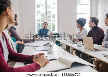 Group of young business people having a meeting at the modern office space. #1332806720
