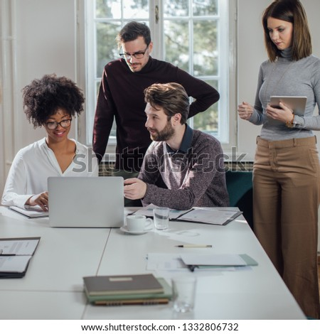 Group of young business people working at the modern office space. #1332806732