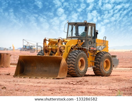 bulldozer on a building site Royalty-Free Stock Photo #133286582