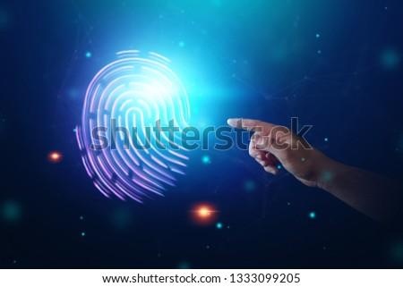 Hologram fingerprint, fingerprint scan on a smartphone, blue background, ultraviolet. concept of fingerprint, biometrics, information technology and cyber security. Mixed media. #1333099205