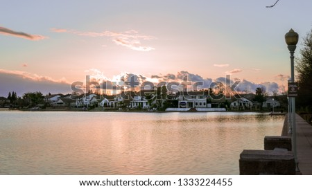 Sunset over man-made lake in Elk Grove California Royalty-Free Stock Photo #1333224455