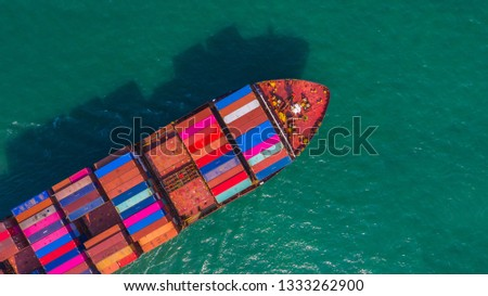 Container ship going to deep sea port, Business logistic import export shipping and transportation by container ship, Aerial view. #1333262900